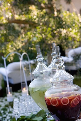 Fresh limeade and punch with oranges at wedding
