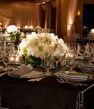 Charcoal grey linens and white floral centerpieces