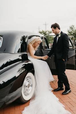 former miss america savvy shields being helped out of classic car by groom before wedding