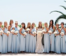 Bride in ines di santo wedding dress with bridesmaids in light blue gowns white bouquets bel air bay