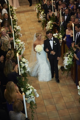 Bride and groom recessional up church aisle