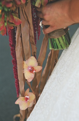 Brown and amber ribbons tied to flower stems