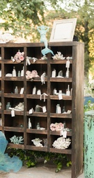 Wood shelf with bottle trinkets and seating cards