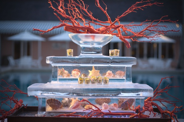 Three tier ice sculpture filled with seashells