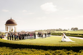the resort at pelican hill wedding under a rotunda, bride walking to the aisle