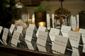 Lacelike, scalloped edge seating cards on table