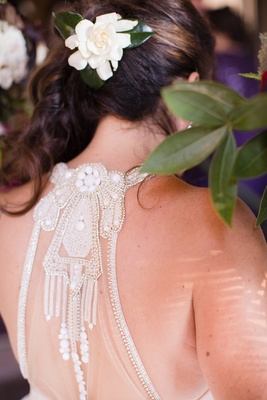detailed back of hayley paige wedding dress, gardenia in hair
