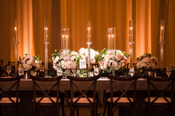 wedding reception low centerpiece tall candles candleholders taper candle rectangular tables