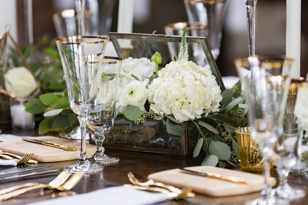rustic reception tablescape with glass box open with white flowers bursting from it