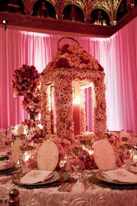Oversize lantern made of flowers on wedding reception table