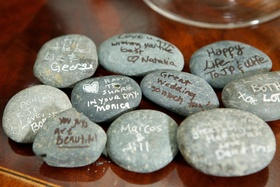 Wedding notes from guests on river rock