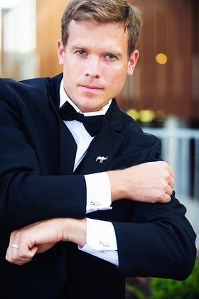 groom wearing suit