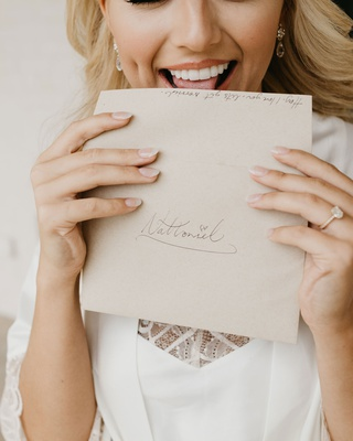 former miss america savvy shields licking envelope for love letter to groom on wedding day