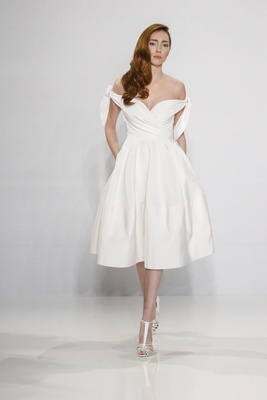 Christian Siriano for Kleinfeld Bridal short mid length skirt wedding dress off the shoulder ties