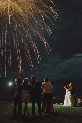 wedding reception private home bride groom and wedding guests watching fireworks