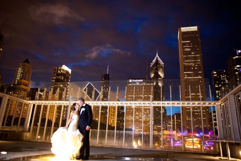 bride in vera wang gown groom in j. crew, Chicago skyline at night