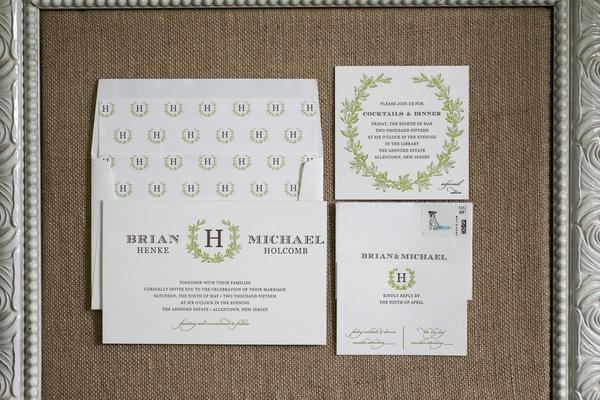 green and white themed wedding invitations with laurel wreath