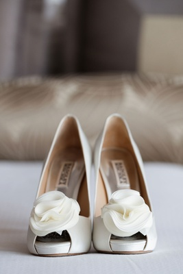 Bride's wedding shoes white badgley mischka shoes white flower detail on peep toe