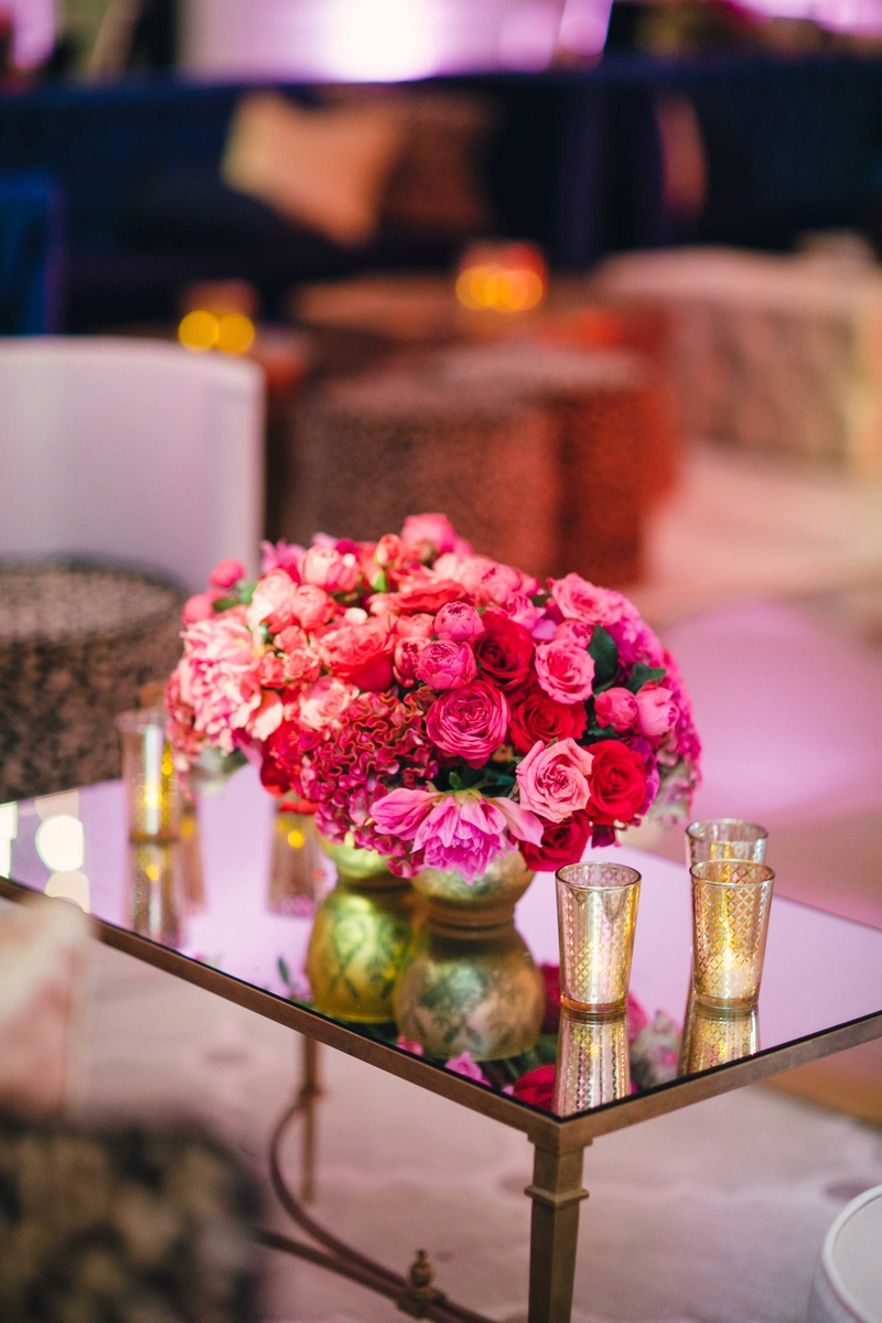 Wedding reception lounge with mirror table and flowers pink rose, red rose, red cockscomb