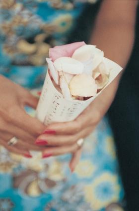 rose petals inside paper sheet music cone