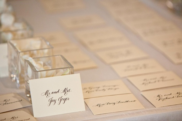 Ivory seating card with black calligraphy lettering