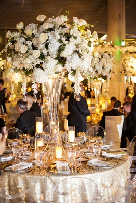 wedding reception, shimmering linens, ghost chairs, roses hydrangeas greenery