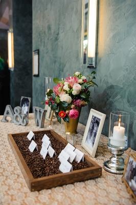 Metal initials and photos around fragrant seating cards