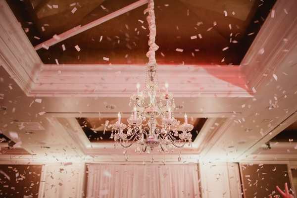 Wedding reception ballroom chandelier with confetti