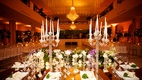 opulent tablescape reception mirror table candelabras white purple green details white napkins