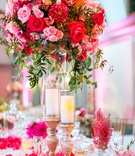 Texture table linen, flower petals, candles, bud vases, tall centerpiece pink rose, pink dahlia
