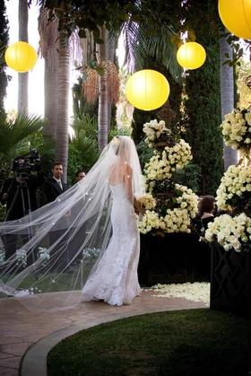 Bride in wedding dress with flower embellished veil
