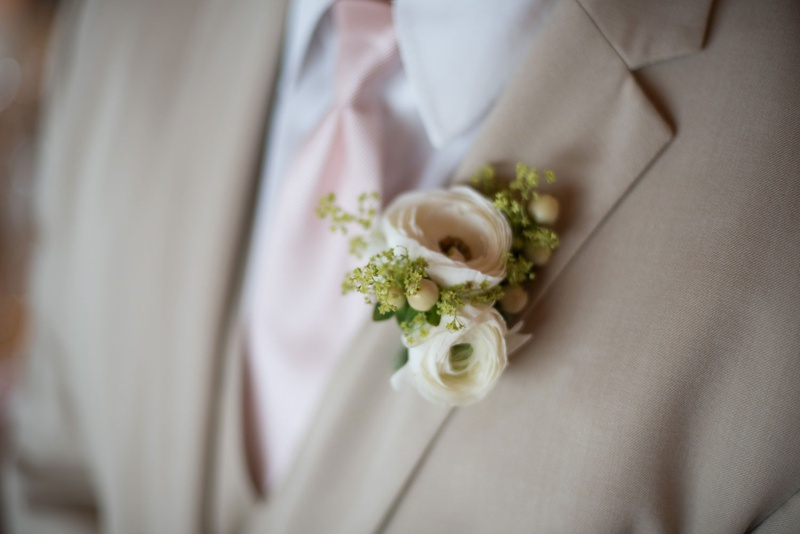 new york jets brian winters wedding, groom in tan suit, boutonniere with ranunculus blossoms