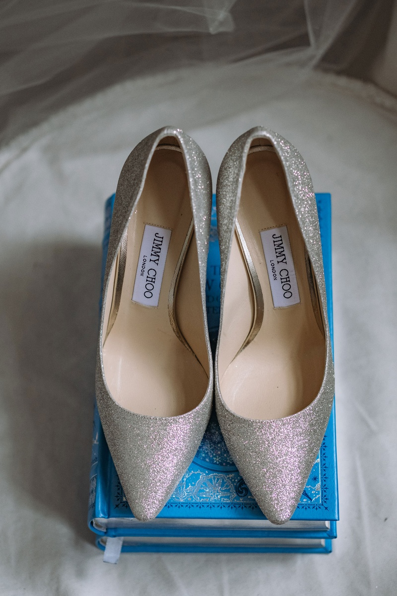 wedding shoes on blue story book ring holder jimmy choo silver glitter heels