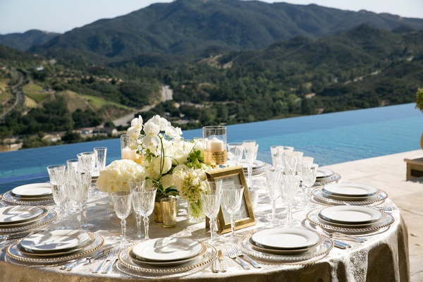malibu rocky oaks wedding reception by infinity pool, centerpiece with white florals