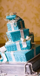 topsy turvy whimsical blue cake white bow