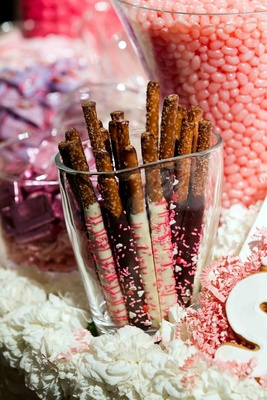 Glass vase filled with chocolate-covered pretzels