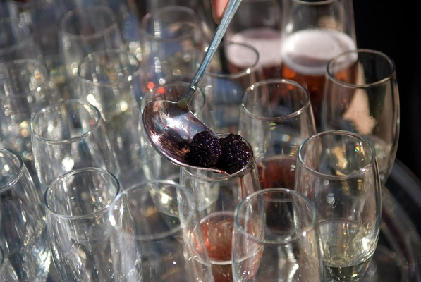 Champagne toasting glasses filled with fruit