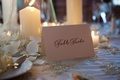 Wedding reception table number spelled out on a cream card