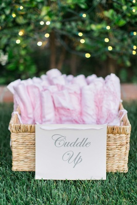 Wedding reception gifts pink shawls and blankets for outdoor reception