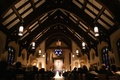 Illinois church wedding ceremony with red and green flowers at altar