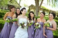 Asian American bride and bridesmaids at vineyard wedding