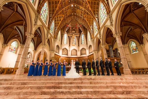 bride in vera wang, groom in vera wang, bridesmaids in cobalt blue bill levkoff, holy name cathedral