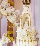 white gold wedding cake castle gold ornate details geode element with castle sculpture crown topper