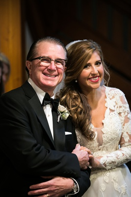 bride in isabelle armstrong lace gown with father of the bride in tuxedo and horn-rimmed glasses