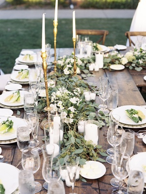 farm tables, garland runner of eucalyptus, golden candlestick