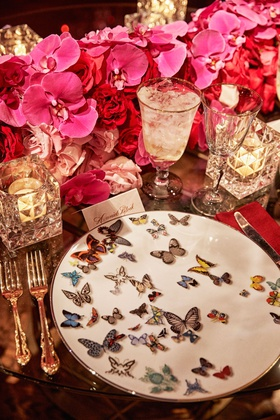 wedding reception place setting red rose fuchsia orchid butterfly plate christian lacroix candles