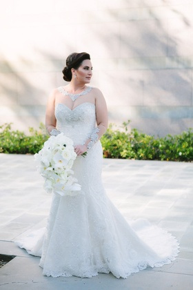 bride in martina liana trumpet gown with illusion neckline and sleeves with silver embellishments