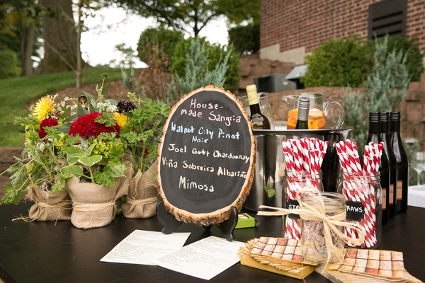 Tree trunk chalkboard menu with burlap flower arrangements