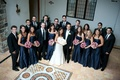Bride and groom with bridesmaids and groomsmen at castle