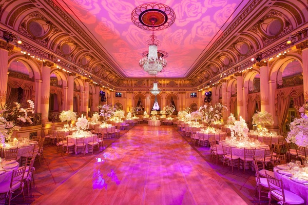 Wedding reception with pink lighting at the Grand Ballroom of The Plaza